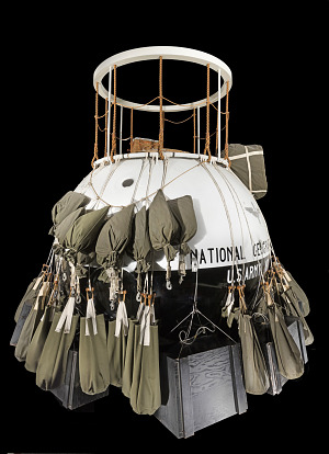 Ball-shaped metal balloon cabin with many canvas ballast bags hanging around center-thumbnail 7