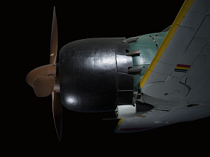 Brown tri-blade propeller on black nose of green Zero Fighter aircraft-thumbnail 5