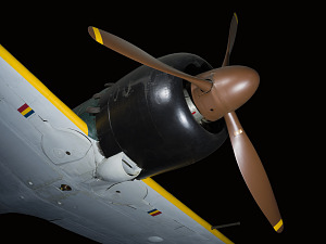 Brown tri-blade propeller on black nose of green Zero Fighter aircraft-thumbnail 8