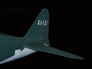Tail of green Zero Fighter aircraft with