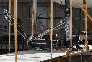 Model of Wright Brother laying flat in 1903 Wright Flyer in museum-thumbnail 2