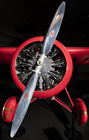 Front engine and silver single-blade propeller on red Amelia Earhart Lockheed Vega 5B aircraft-thumbnail 23