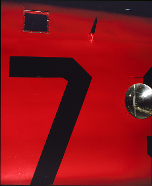 Close up of wing of red Amelia Earhart Lockheed Vega 5B aircraft-thumbnail 3