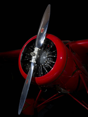 Front engine and silver single-blade propeller on red Amelia Earhart Lockheed Vega 5B aircraft-thumbnail 9