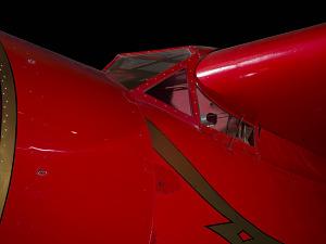 Outside of cockpit of red Amelia Earhart Lockheed Vega 5B aircraft