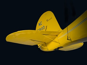 View of the vertical and horizontal stabilizers on tail of yellow Staggerwing aircraft-thumbnail 6