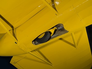 View of undercarriage and retractable landing gear tire on back of Staggerwing aircraft-thumbnail 7