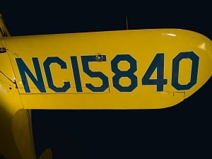 Aircraft registration mark in blue on yellow Staggerwing wing,