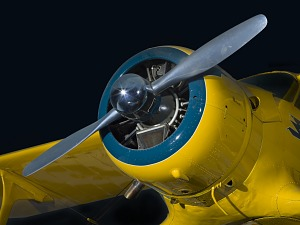 Closeup view of the two-blade propeller and engine from yellow Beechcraft C17L Staggerwing                 aircraft-thumbnail 13