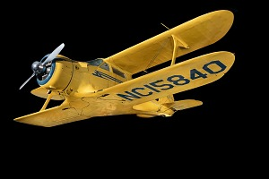 Overall view of yellow Beechcraft C17L Staggerwing aircraft-thumbnail 1