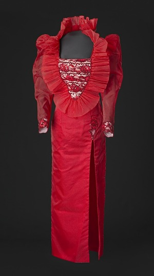 Image for Red dress with ruffled collar designed by Peter Davy