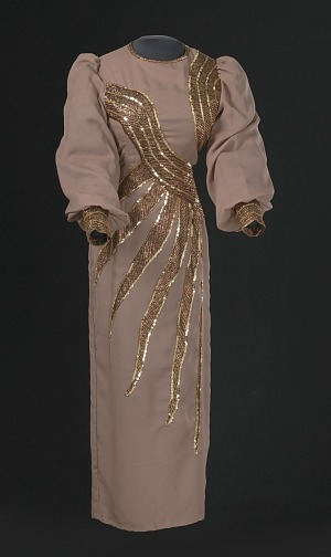 Image for Brown crepe dress with metallic embellishments designed by Peter Davy.