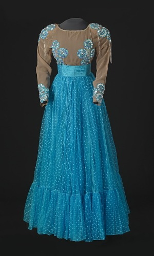 Image for Turquoise blue dress with nude bodice and blue details designed by Peter Davy