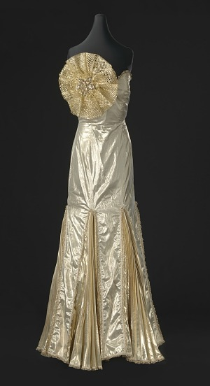 Image for Gold lamé strapless dress designed by Peter Davy