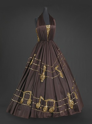 Image for Brown halter dress with gold music themed embellishments designed by Peter Davy