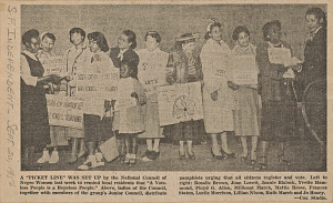 Image for Newspaper clipping of women distributing voter registration pamphlets