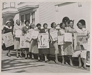 Image for Photograph of women activists with signs for voter registration