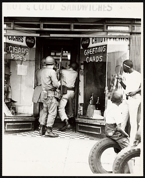 Image for Photograph of soldiers entering a store during the Newark Riots