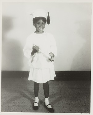 Image for Studio portrait of a young girl in graduation cap
