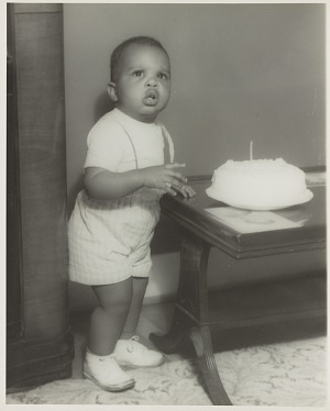 Image for Studio portrait of a young boy with a birthday cake