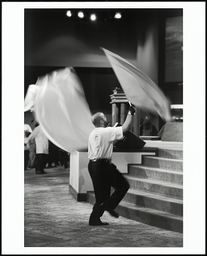 Image for A member of the praise team uses flags to usher in the spirit of the Lord at Evangel Fellowship COGIC, Greensboro, North Carolina, 2005