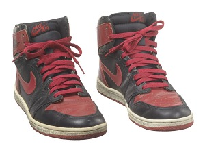 3b724bc8 Description: A pair of Nike brand red and black Air Jordan I high top  sneakers, also known as the