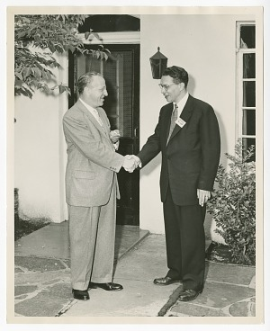 Image for Photograph of Gilbert E. DeLorme. Sr., shaking hands with an unidentified man