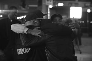 Image for Digital image of protesters embraced in a hug
