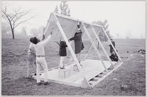 Image for Photograph of John Wiebenson and others building a structure