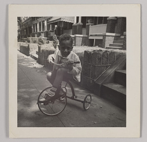 Image for Photographic print of Charles H. Houston, Jr. as a child on tricycle