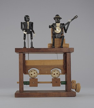 Image for Crank toy in the form of a minstrel banjo player and minstrel male dancer