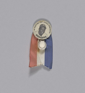 Pinback button of Jackie Robinson with baseball charm and