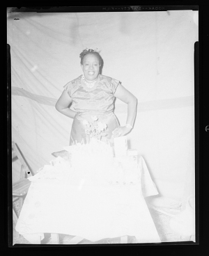 Image for Indoor Portrait of a Woman Standing in front a Cake, Diamond Tooth Mary