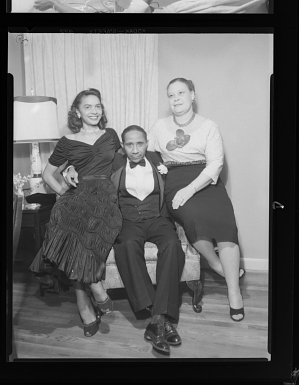 Image for Indoor Photo of One Man and Two Women Sitting, Doctors and Wives