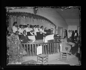 Image for Indoor Photo of Girls Singing with a Christmas Tree