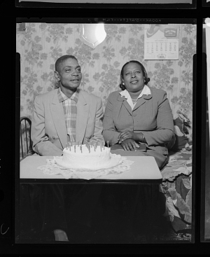 Image for Indoor Portrait of a Man and Women Sitting at a Table with a Birthday Cake
