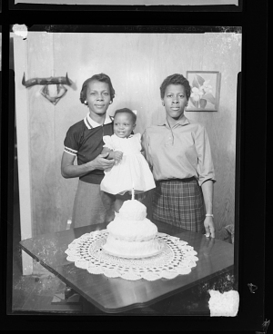 Image for Indoor Portrait of Two Women Standing with a Toddler and a Birthday Cake