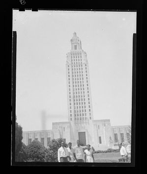 Image for Outdoor Photo of Two Men and Two Women Standing in front of a Building