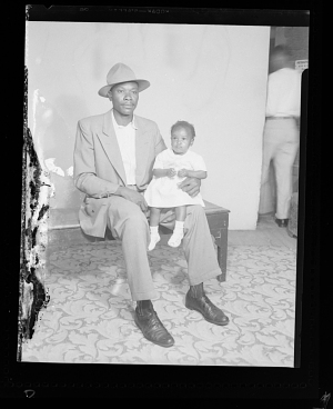 Image for Studio Portrait of a Father Sitting and a Toddler Girl Sitting on his lap