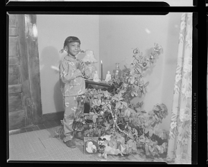 Image for Indoor Photo of a Girl Standing in front of a Christmas Tree, Ruby Washington
