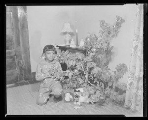 Image for Indoor Photo of a Girl Sitting in front of a Christmas Tree, Ruby Washington