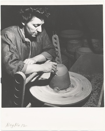 thumbnail image for Laura Andreson at wheel trimming a pot
