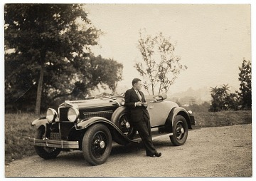 thumbnail image for Harry Bowden leaning on a car