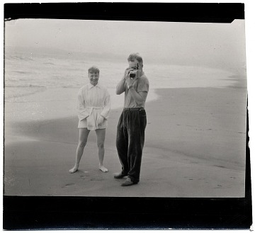 thumbnail image for Harry Bowden taking a photograph on the beach