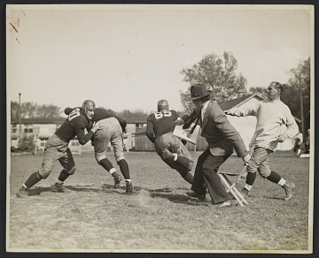 thumbnail image for Photograph of John Steuart Curry sketching a football practice at the University of Wisconsin-Madison