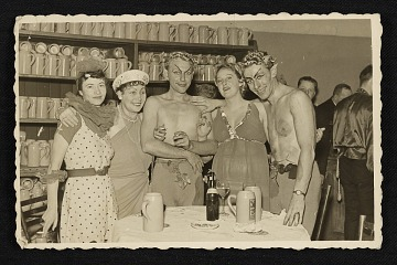 thumbnail image for Five people in costume at a Munich beer house