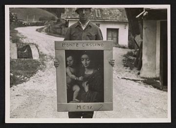 thumbnail image for Unidentified G.I. holding a painting of the Madonna and child, at Altaussee, Austria