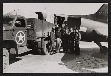 thumbnail image for Soldiers standing by a truck and plane at Munich airport