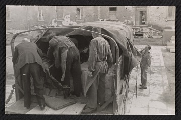 thumbnail image for Men loading a truck with a shipment of art at Munich Central Collecting Point