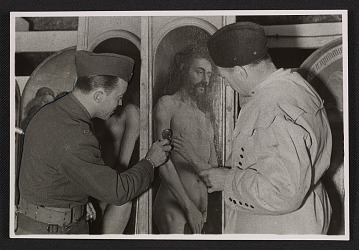 thumbnail image for Lieutenant Daniel J. Kern and Karl Sieber examining a panel of the Ghent Altarpiece